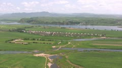 Overview of a North Korean village from the Chinese town of Dandong Stock Footage