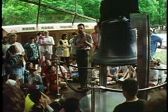 The Liberty Bell, Philadelphia, crowd and ranger speaking & pointing to bell Stock Footage