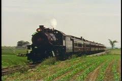 Strasbourg Steam Train passes right to left, near Lancaster Pennsylvania Stock Footage
