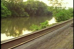 "Amtrak's ""Broadway Limited"", POV out window, river retreating Stock Footage"