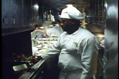 "Amtrak's ""Broadway Limited"", Chef and assistant cooking in the galley, 3 shots Stock Footage"
