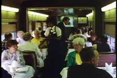 "Amtrak's ""Broadway Limited"", Dining car, wide view with servers and diners - stock footage"