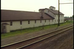 "Amtrak's ""Broadway Limited"" POV out side of train, passing barns and farms Stock Footage"
