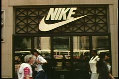The Nike Store, on North Michigan Avenue, Chicago, Illinois, crowd and cars pass Stock Footage