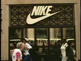 Stock Video Footage of The Nike Store, on North Michigan Avenue, Chicago, Illinois, crowd and cars pass