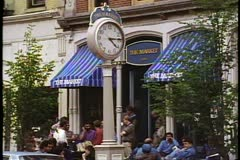 """Street cafe, people, tall clock, shot in """"loDo"""" Lower Downtown in Denver Stock Footage"""