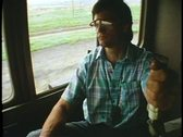 The Engineer in the locomotive cab of