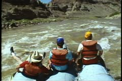 Rafting on The Colorado River , POV bow, three men astride, slow motion Stock Footage