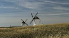 Spain Mota del Cuervo windmills on a grassy hill Stock Footage