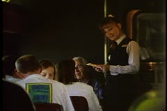 "Amtrak's ""California Zephyr"" Dining Car, female server takes order from table - stock footage"
