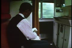 """California Zephyr"", Sleeping Car, sleeping car attendant makes up the berths - stock footage"