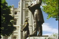 A medium shot of the statue of Joseph Smith and The Mormon Temple Stock Footage
