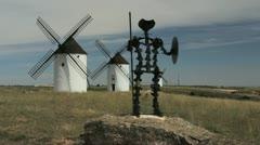 Spain Mota del Cuervo windmills with statue Stock Footage