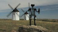 Spain Mota del Cuervo windmills with statue Stock Footage