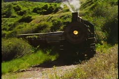 The Heber Valley Steam Train, steam locomotive passes by slowly, mountains Stock Footage