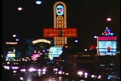 Nighttime on the Strip, traffic, neon signs, The Frontier Hotel, Las Vegas 1995 Stock Footage