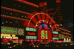Nighttime on the Strip, traffic and Harrah's Showboat,  Las Vegas, Nevada Stock Footage