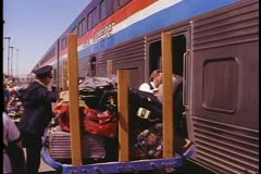 "Amtrak's ""Desert Wind"", conductor and porter load bags onto train at Las Vegas Stock Footage"