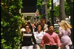 Crowd on a sidewalk in Beverly Hills, California, shot in 1995 Stock Footage