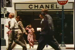 Chanel store, Beverly Hills, California, crowd crossing street, shot in 1995 Stock Footage