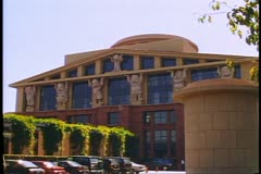 The Walt Disney Company headquarters with seven dwarfs holding up the roof - stock footage