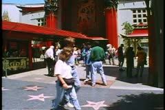 Grauman's Chinese Theatre, lots of people in courtyard, wide shot, Hollywood Stock Footage
