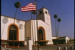 Union Station in Los Angeles, Spanish Mission Architecture, flag waving Stock Footage