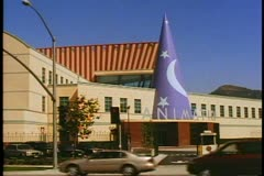 The Walt Disney Animation Building with sorcerer's cone hat and traffic Stock Footage