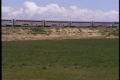 "Amtrak's ""California Zephyr"" pass by shot of streamliner train with cattle Stock Footage"