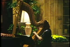 Harpist playing in the lobby of the Brown Palace Hotel in Denver, Colorado Stock Footage