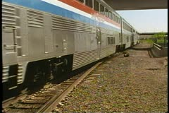 "Amtrak's ""California Zephyr"", the train retreats from the station at Denver - stock footage"