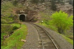"POV from locomotive, Amtrak's ""California Zephyr""  train enters a tunnel - stock footage"