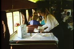 "Amtrak's ""California Zephyr"", The Dining Car, waitress sets table Stock Footage"