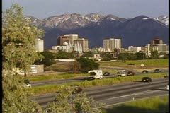 Salt Lake City, Utah skyline, mountains and interstate highway, classic view Stock Footage
