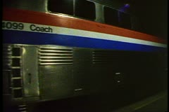 "Amtrak's ""Desert Wind"", silver streamliner train departs at night, detail cars Stock Footage"