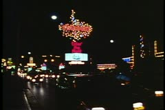 Nighttime on the Strip, traffic, neon signs, The Stardust Hotel, 1995, Las Vegas Stock Footage