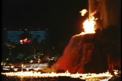 The Mirage Hotel Volcano explodes, side shot, Nighttime on the Strip, Las Vegas - stock footage