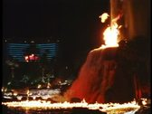 The Mirage Hotel Volcano explodes, side shot, Nighttime on the Strip, Las Vegas Stock Footage
