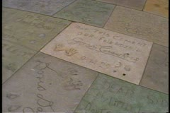 Grauman's Chinese Theatre, Hollywood, POV shot of the famous footprints Stock Footage