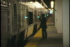 "Conductor walks platform before departure of Amtrak's ""California Zephyr"" - stock footage"