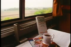 "Coffee cup and menu on a shelf,  POV out window  Amtrak's ""California Zephyr"" - stock footage"