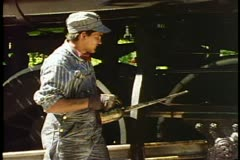 Heber Valley Steam Train, young man oils wheels Stock Footage