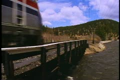 "Amtrak's ""Southwest Chief"" Train, pass by shot over river in the mountains Stock Footage"