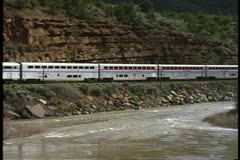 "Pass by shot of Amtrak's ""California Zephyr"" along the Colorado River - stock footage"