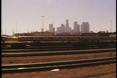 "Amtrak's ""Desert Wind"", POV out of window, Los Angeles skyline and rail yards Stock Footage"
