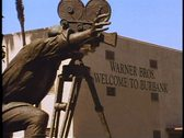 Stock Video Footage of Warner Bros. Studios in Burbank, California, a bronze cameraman, zoom out