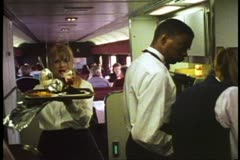 "Amtrak's ""California Zephyr"", female server carries deserts down the aisle Stock Footage"
