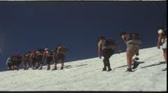Hikers on glacier (vintage 8mm film) - stock footage