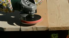 Grinder tool grinding wooden table in the garden Stock Footage