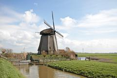 Traditional windmills in dutch landscape in the netherlands Stock Photos